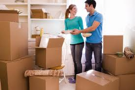 couple moving with boxes